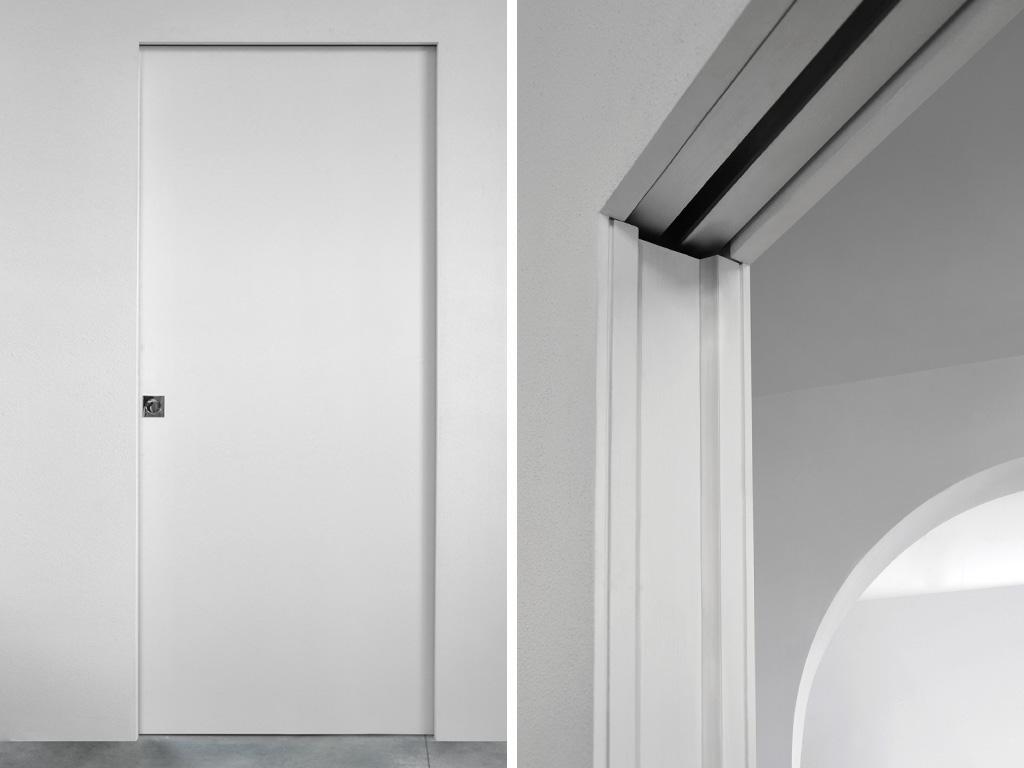 Porta l 39 invisibile finart serramenti for Porte filo muro cartongesso
